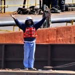 Industrial Photography of Barge Worker